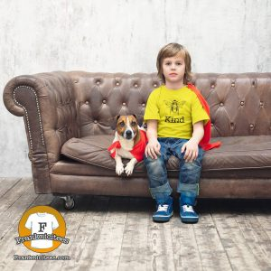 """a boy and his dog, boy is wearing a """"Bee Kind"""" shirt"""