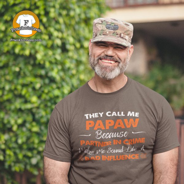"A military man wearing a t-shirt that says ""They Call Me Papaw because calling me partner in crime makes me sound like a bad influence"""