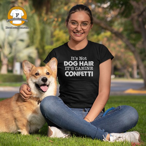 """Woman with a corgi -wearing a t-shirt that says """"It's Not Dog Hair It's Canine Confetti"""""""