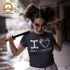 "Girl wearing a shirt that says ""I heart Halloween"" with skeleton fingers"
