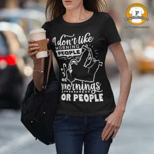 woman wearing a shirt that says I don't like morning people, or mornings, or people.